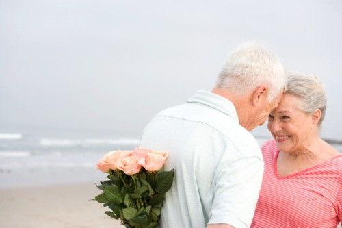 Loving Senior Couple on Beach --- Image by © Ronnie Kaufman/Corbis